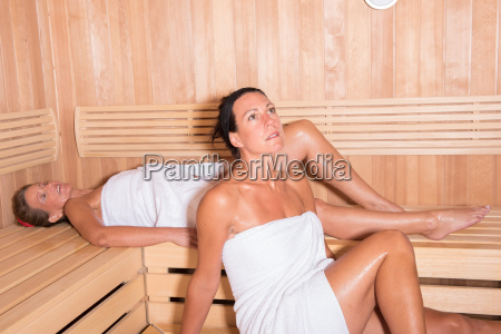 two attractive women in the sauna