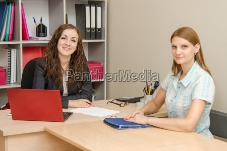 two young women in office