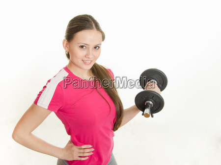 self confident athlete with dumbbells in