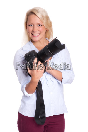 blond woman holding a camera