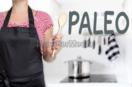 paleo cook holds cooking spoon background