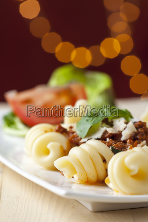 closeup of spirelli with sauce bolognese