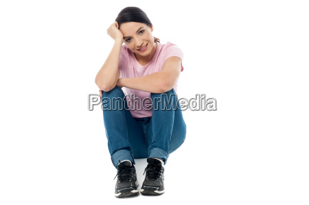 woman crouched on floor