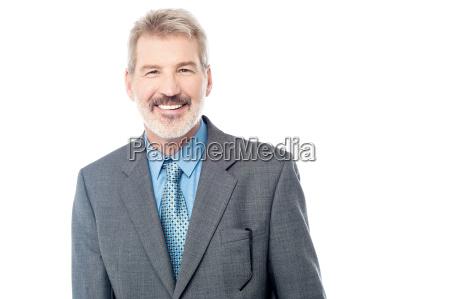 happy businessman posing to camera