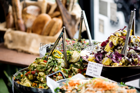 assorted fresh salads displayed on a