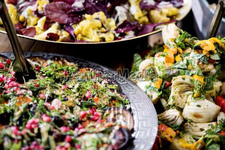 an assortment of salads on a