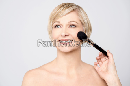 sexy young woman getting makeup