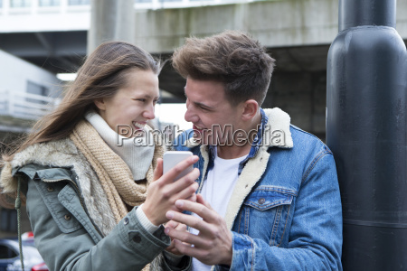 couple looking at a smartphone in