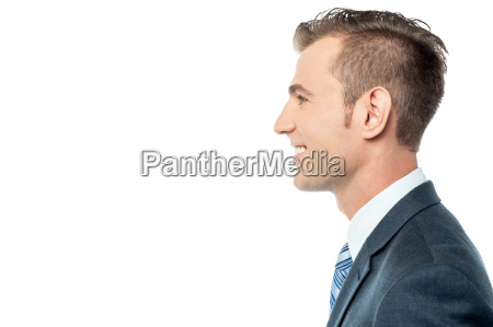 side pose of a young businessman