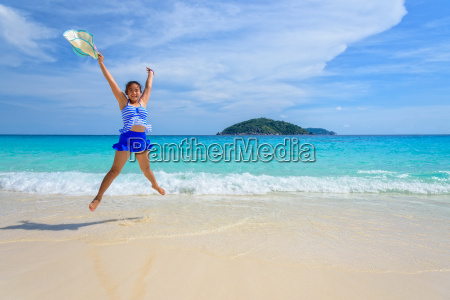 girl jumping with happy on the