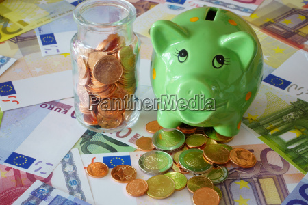 piggy bank and glass with euro