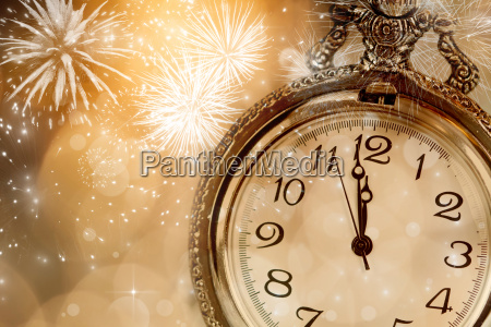 old clock with fireworks and holiday