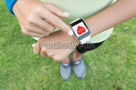 sport woman touch on hand watch