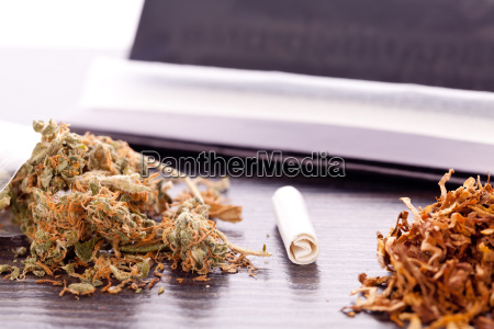 cannabis marijuana with paper and joint