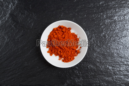 paprika in a bowl on slate