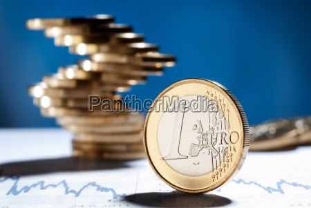 euro coin with a stack of