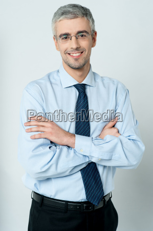 young employee posing with his arms
