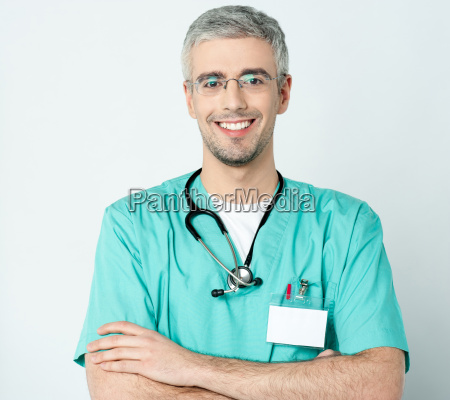 smiling doctor with his arms crossed