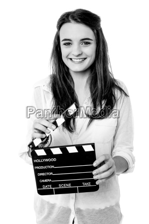 charming girl with clapperboard
