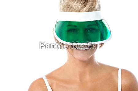 smiling woman wearing green cap