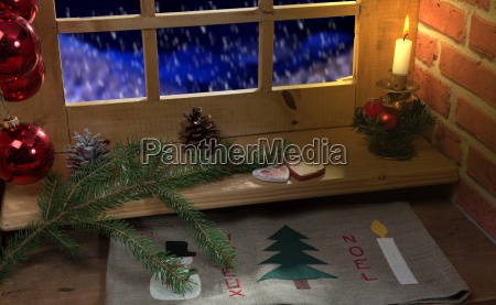 window decoration christmas candle and snow