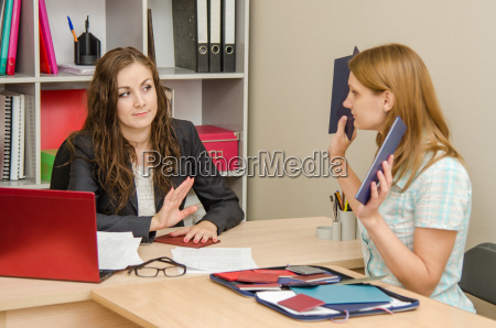 girl shows hr specialist diplomas which