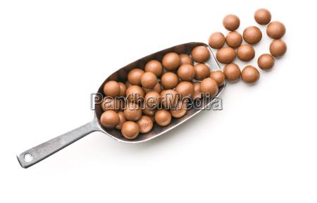 chocolate balls in metal scoop