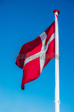 denmark flag on a pole