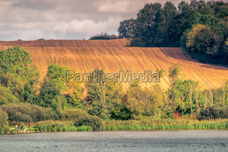agricultural hillside fields above a lake