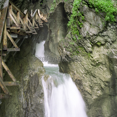 waterfall with wooden walkway in the