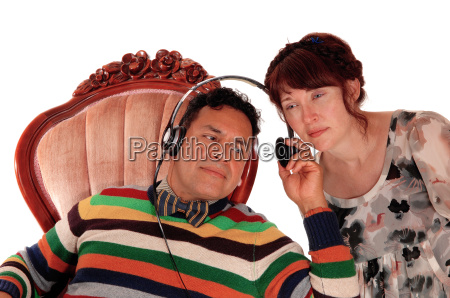 husband and wife listening on headphone