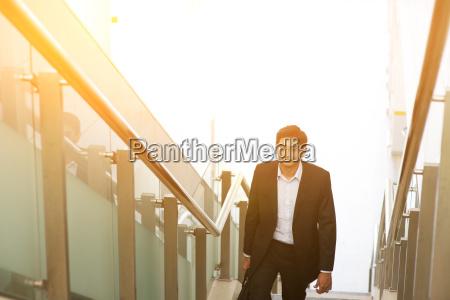 indian businessman ascending steps