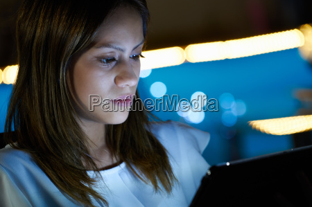 latina teenager using tablet pc indoor