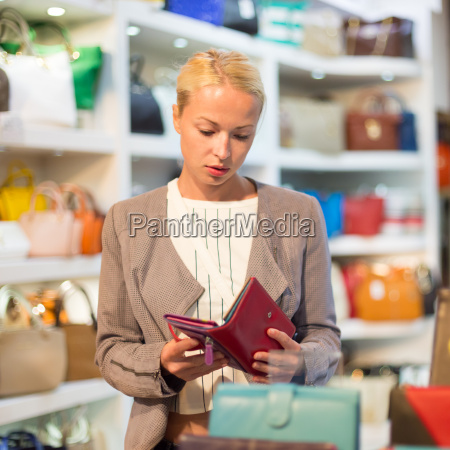 casual blond woman shopping for leather