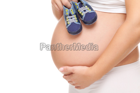 pregnant woman holding a pair of