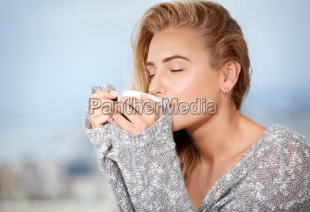 female having morning coffee