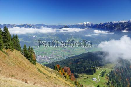 paraglider flies towards the beautiful landscape