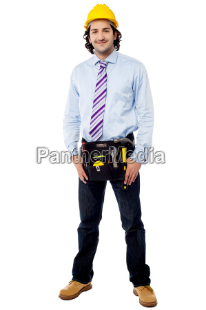 handsome architect wearing tool kit belt