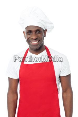 smiling male chef in uniform