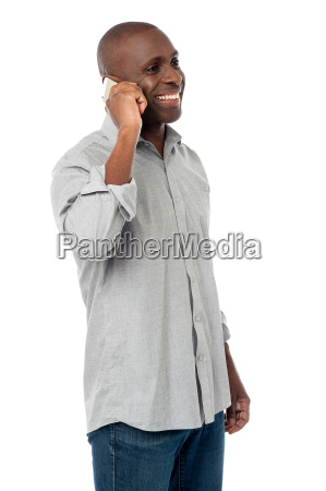 handsome male talking on phone