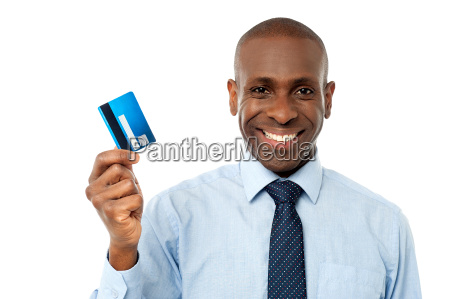 businessman holding a credit card
