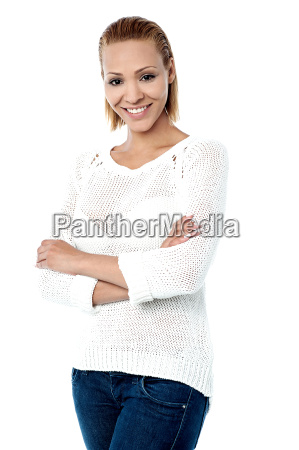 trendy woman posing with arms crossed