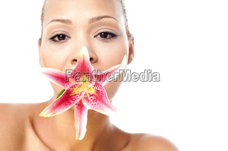 pretty woman with lily flower in