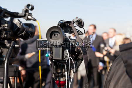 news conference filming an event with