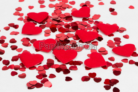 red hearts confetti and fabric heart