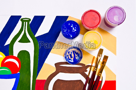 bottles with gouache paints and brushes
