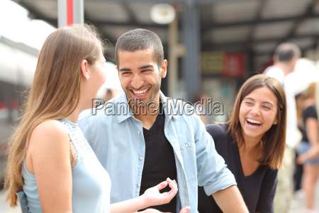 three friends talking and laughing in