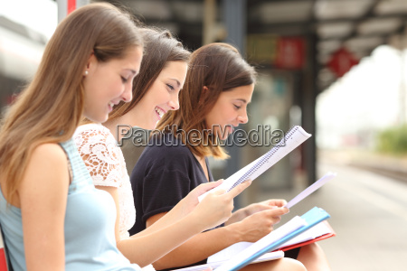 three students studying and learning in