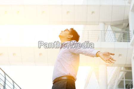 asian indian businessman arms outstretched