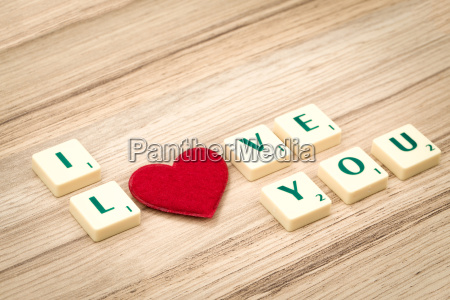 valentines hearts on a wooden background